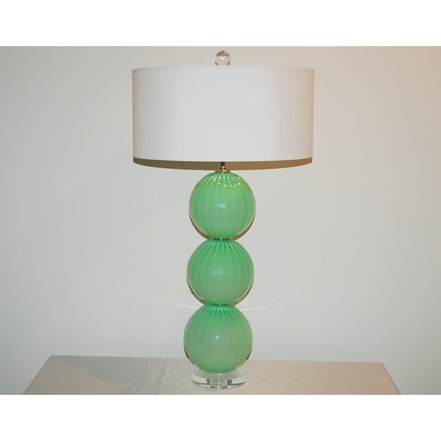 Matched pair of hand blown Three-Ball glass lamps by Joe Cariati in GREEN FROST. Vertical ribs add optical and dimension....