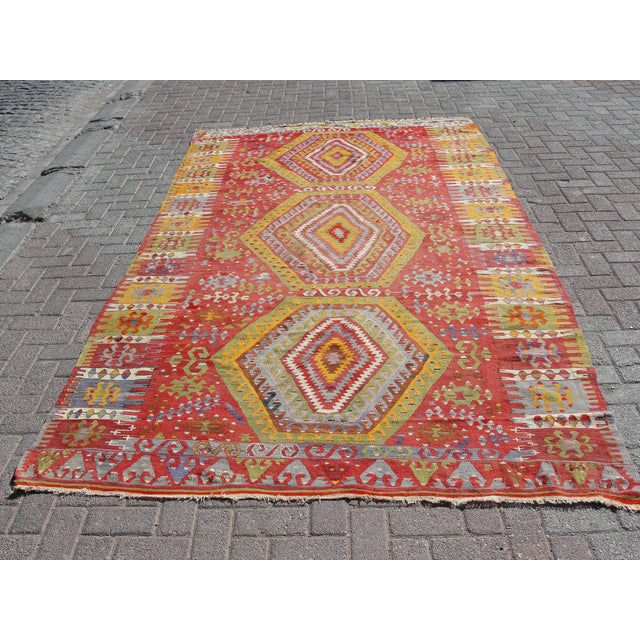 Vintage handwoven Turkish kilim rug. The kilim is nearly 75 years old. It is handmade of very fine quality natural wool in...