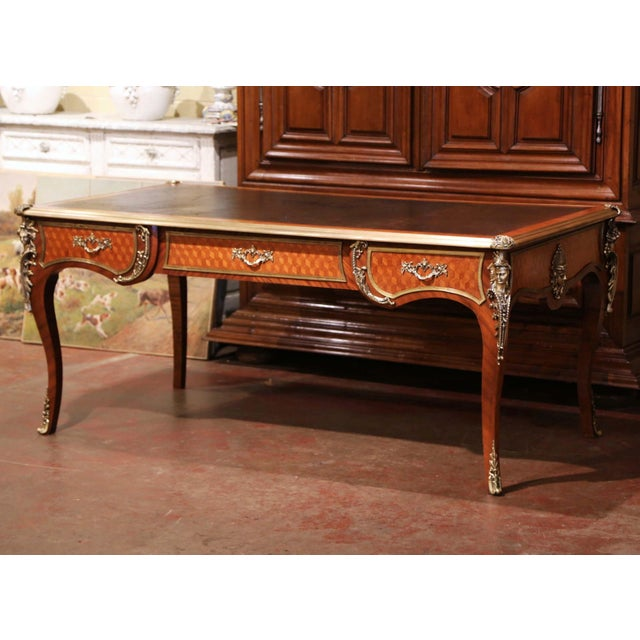 Crafted in Paris, France, circa 1870 in the style of Francois Linke and built of walnut with oak parquetry, the large...