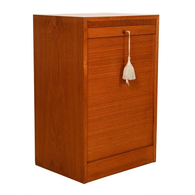Upgrade your office with this Danish Modern filing cabinet. Pull up the tambour door to disguise the two hanging file...