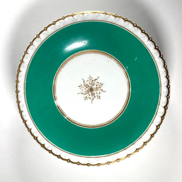 A wonderful and usable pair of porcelain dessert tazzas, elegantly decorated with a moulded edge, wide green borders, and...