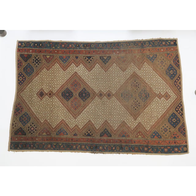 Beautiful vintage Persian rug. Flatweave with some wear and tear and fraying along one edge. Deep red, blue, tan and white...