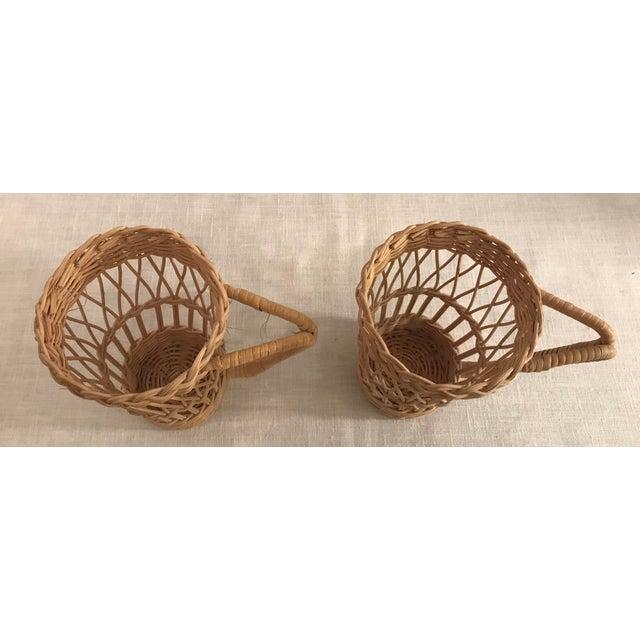 Nice pair of vintage wicker handled glass holders.