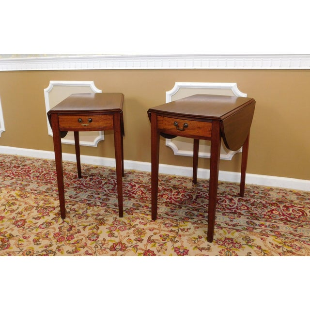 Good vintage pair of mahogany Federal style drop leaf Pembroke end tables, c1960s. remnants of the M.C. & Co blue label...