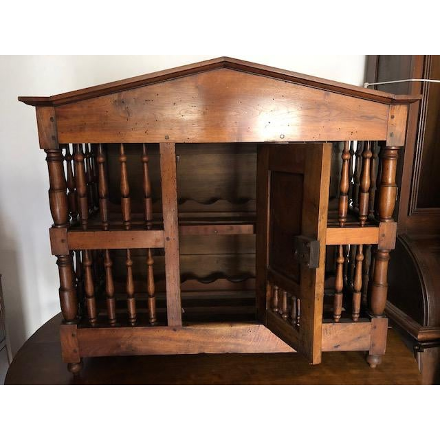 This is a mid 19th century French country panettierre converted into a two-layered wine rack. One center door; cabinet...