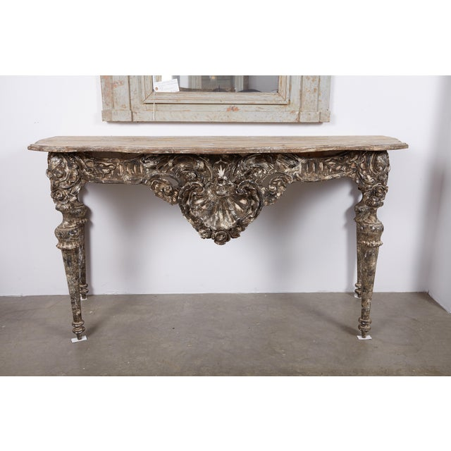 A fabulous 18th Century Italian Baroque Console Table. Comprised of walnut and pine wood. Top patina , natural pine with a...