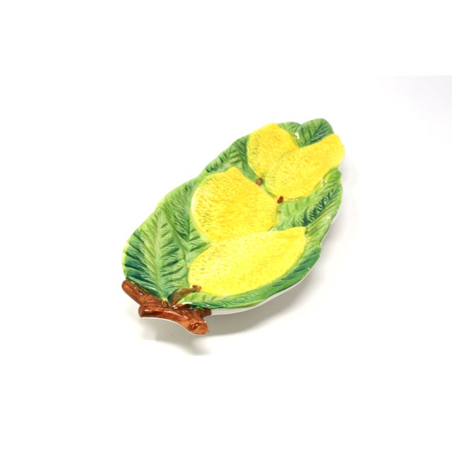 A vintage, hand-painted dish with embossed lemons and leaves design. Made in Italy. Good vintage condition; minor chip...