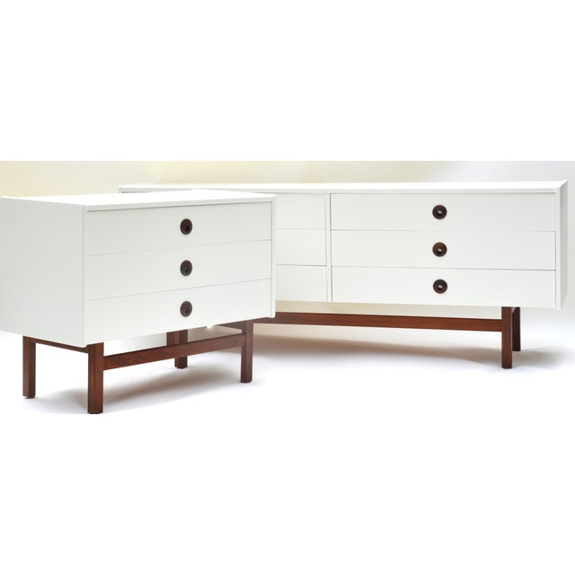 A rare and wonderful Brown Saltman mid century modern dresser set, newly ivory-white re-lacquered with walnut base and...