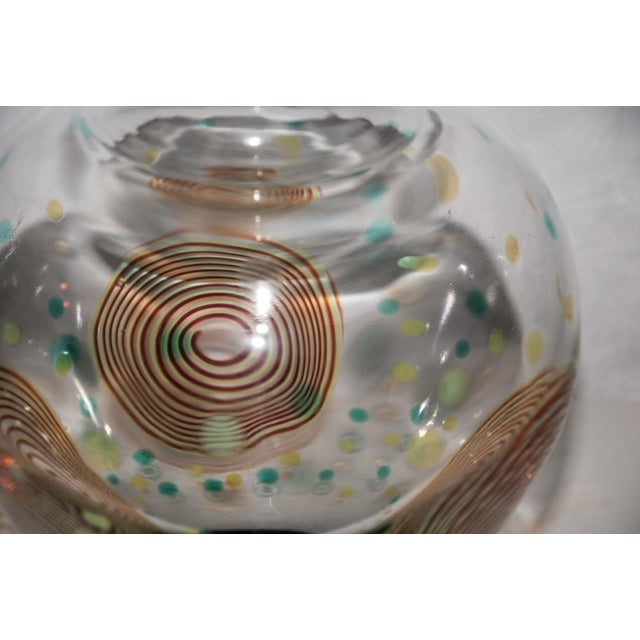 Circa 1990 A large and stunning multicolored Murano glass vase by Salviati. The whimsical design incorporates three large...