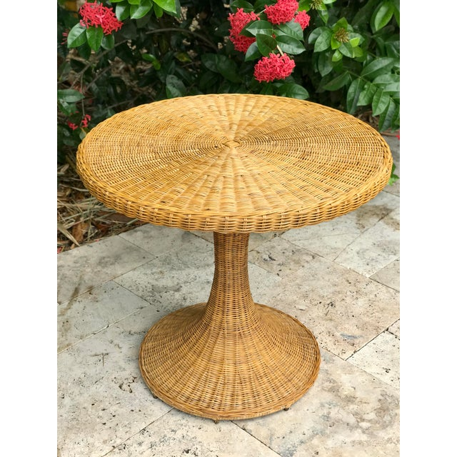 """Chic mid century wicker/rattan table. According to Wicker Warehouse, """"Rattan is the material that indoor wicker furniture..."""