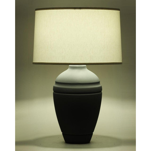 """A charcoal gray crackle finish ceramic table lamp with ivory linen shade made in the USA. Shade dimensions: 18"""" x 19"""" x 12"""""""