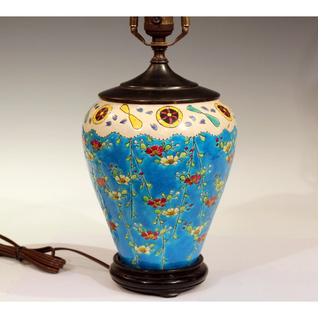 Interesting antique Japanese studio enamel ware lamp, circa 1920s. Decoration looks like ships wheels, plane propellers...