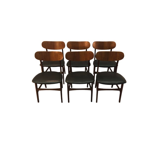 1960s set of six Danish teak round back dining room chairs with new naugahyde seats. The chairs are attributed to Johannes...