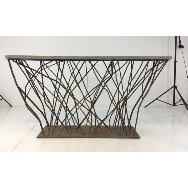 Industrial modern Currey & Co. concrete and rebarb prototype console table