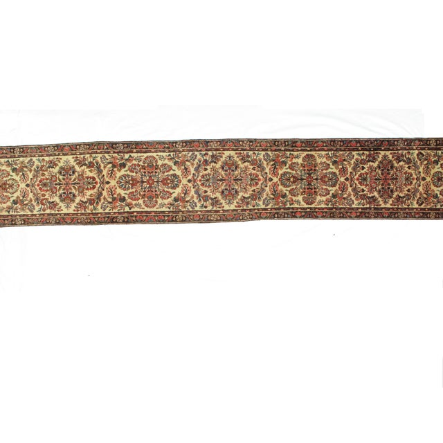A hand-made, wool pile, that is an antique, Persian Hamadan runner in excellent condition.
