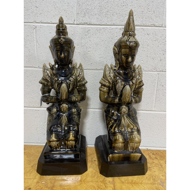 Very cool large ceramic Buddha's in a mottled drip sort of glaze finish. Greens and black. Black wood painted bases are...