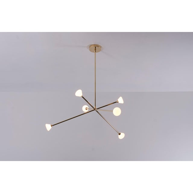 The Nova chandelier is centerpiece fixture with an elegant and energetic composition. This contemporary chandelier...