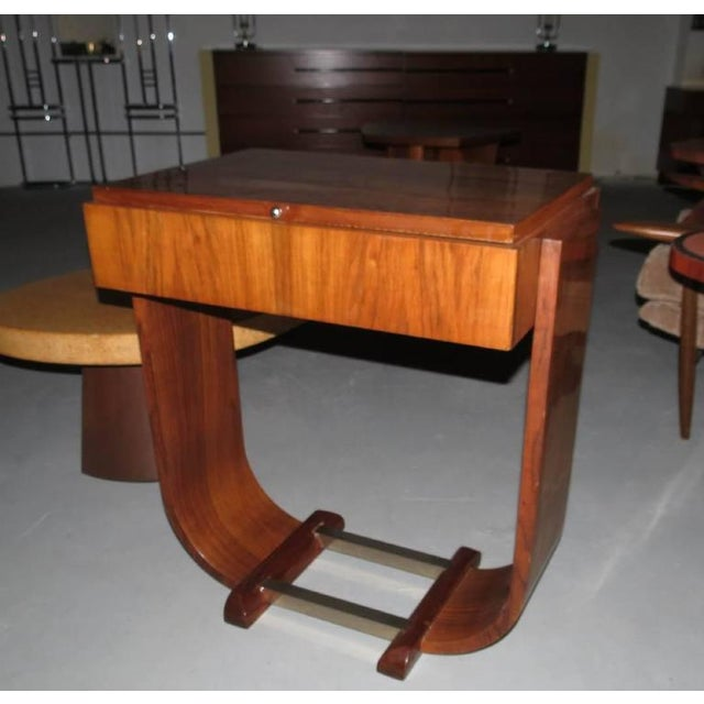 Stunning French Art Deco console is from 1930s. Constructed of Brazilian rosewood and Brazilian rosewood veneers. The lop...