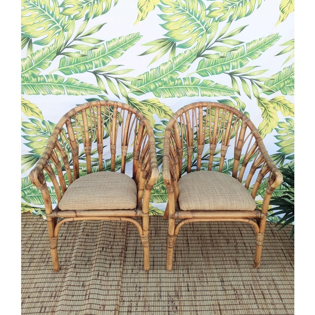 A beautiful pair of vintage bamboo side chairs. The chairs have been freshly upholstered in a nice wheat colored...