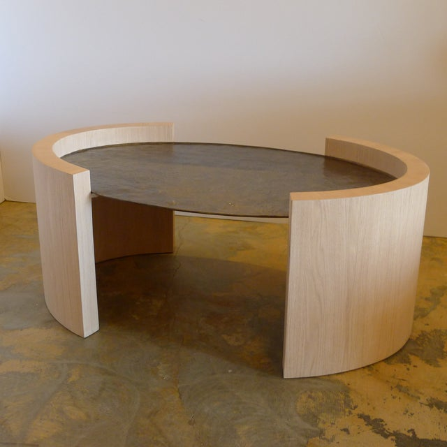 Paul Marra Oval Oak and Hand Hammered Steel Cocktail Table. Contemporary table with hand hammered steel and with clear-...