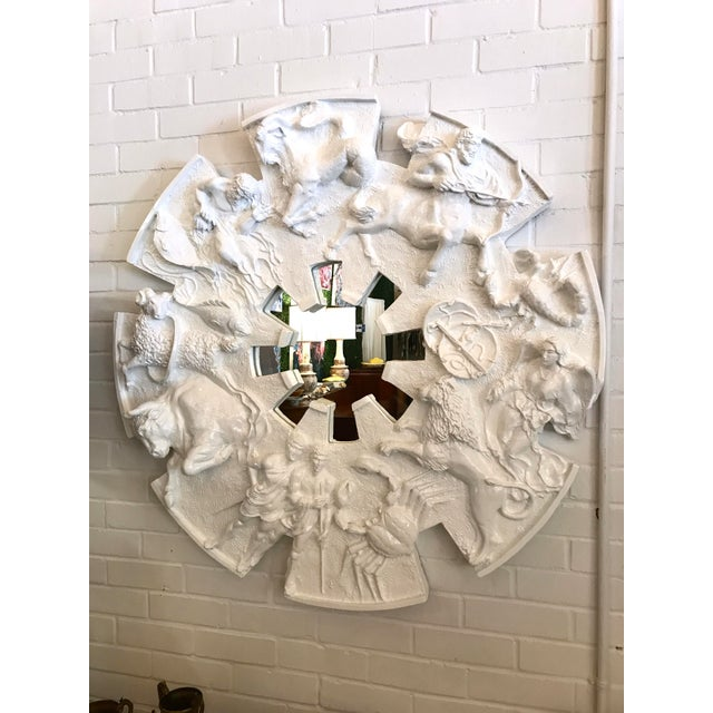 """A truly special mirror! Designed by Finesse in the 1970's this brutalist """"zodiac mirror"""" features a representation of all..."""