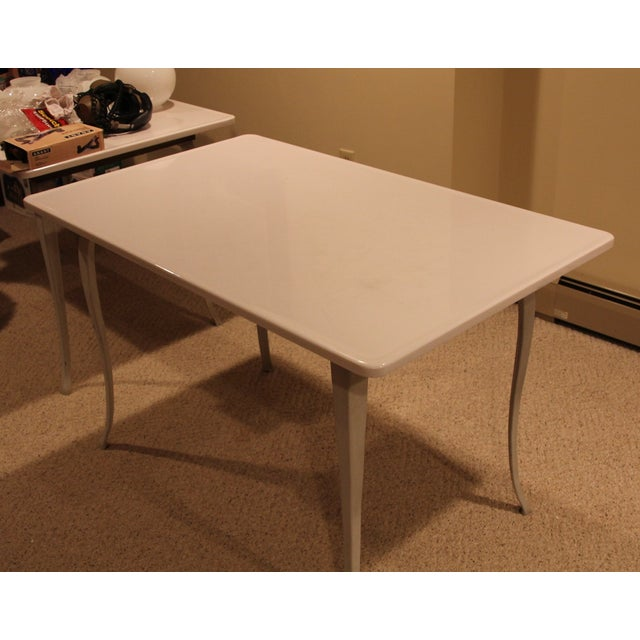 This is a stunning table with a milk glass top. It is in amazing condition for it's age. These tables were made for...