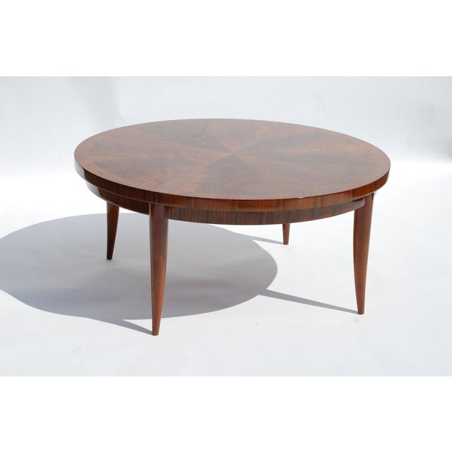 Round cocktail table with highly figured, book matched,crotch mahogany veneer top. We offer free delivery within the Long...