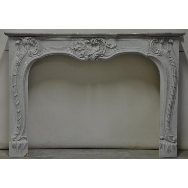 Southern France 19th century porcelain Neo Rococo fireplace, very decorative. Opening measurements : 32.2 x 40.5 inch...