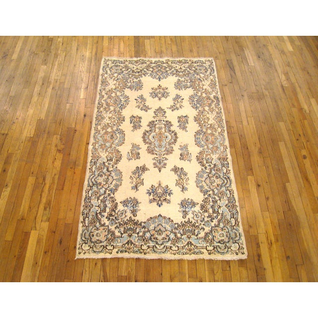 """A vintage Persian Kerman oriental rug, size 6'9"""" x 4'0"""", circa 1940. This lovely hand-woven Persian carpet features a..."""