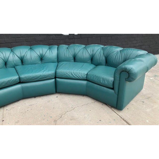 An absolutely stunning tufted leather sofa by A. Rudin. This 1970's sofa is a deep greenish blue turquoise color that's...