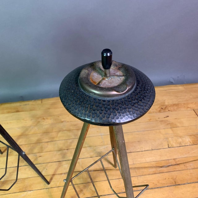 A unique and rarely available pair of small standing ashtrays from Italy - likely early 1940s on tripod metal legs and a...