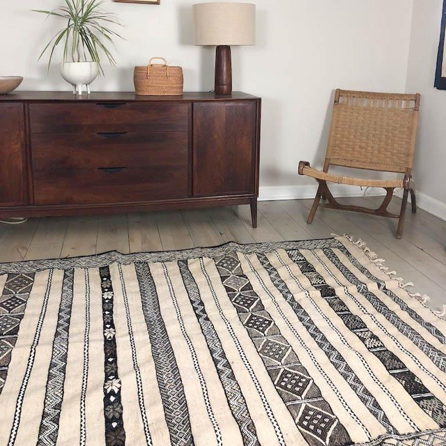 This is a beautiful, wool kilim rug meticulously woven by hand by our partner weaving cooperative in Boujad, Morocco. The...