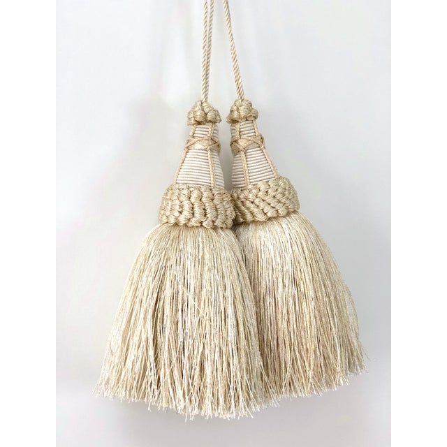 Pair of handmade cream and white colored key tassels with looped ruche, twisted cord and full skirt. These have a true...