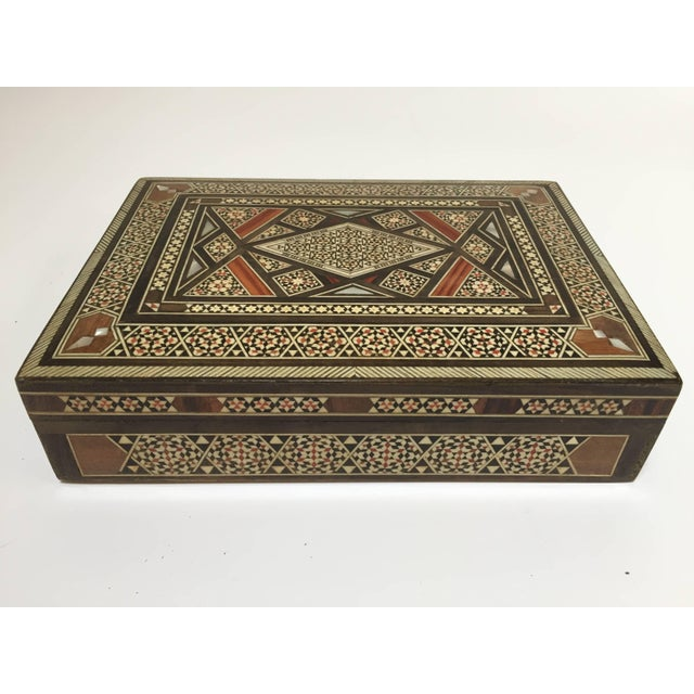 Exquisite Middle Eastern Syrian inlay jewelry box intricately inlaid with Moorish motif designs which have been...