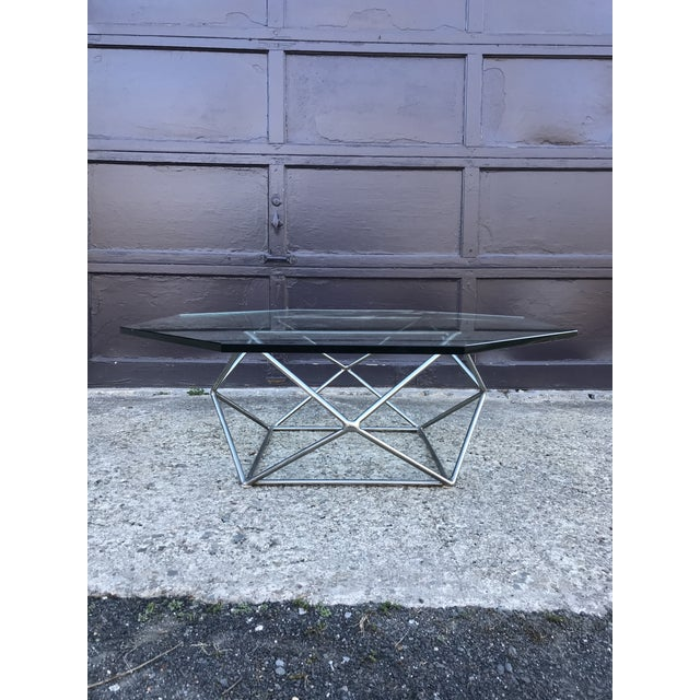 Great sculptural coffee table designed by Milo Baughman for Directional Furniture. Base is steel with a bronze tint to it....