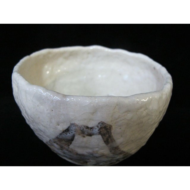 """Japanese studio pottery bowl. Heavily textured natural tone glaze with brown mountain-like design. Measures 5 1/4"""" x 4""""..."""