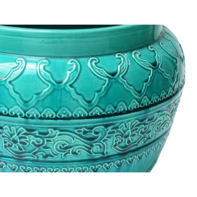 Bring out the colors in your living room or add a splash with this lovely English Majolica turquoise glazed planter....