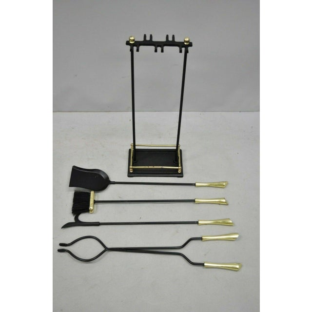 Vintage Brass and Iron Modernist Mid Century Modern Fireplace Tool Set (Stand, broom, tongs, poker, and shovel). Item...