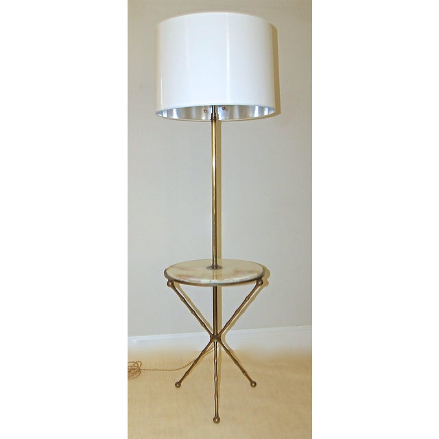 This is a beautiful and bronze faux bamboo lamp table with inset onyx top and tripod legs, attributed to Maison Bagues....