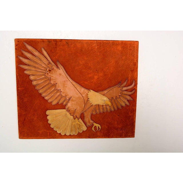 For your consideration a Folk Art eagle in leather patch work mounted in canvas wood frame. Leather is cut to form the...