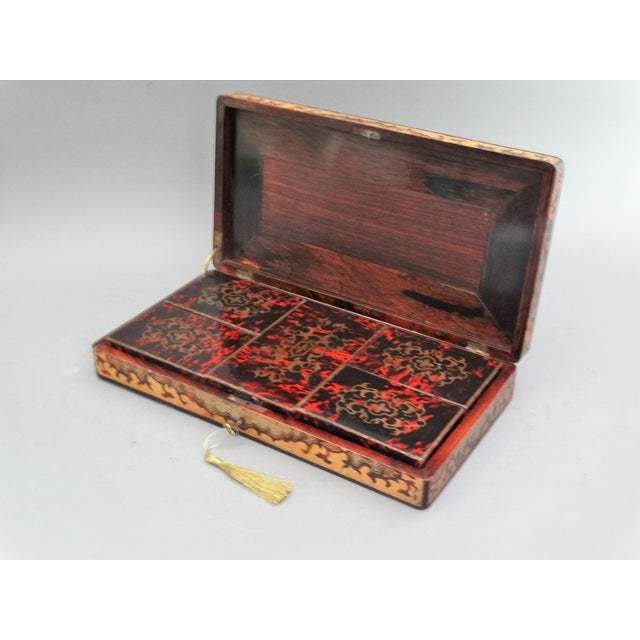 A lovely 19th-Century French playing cards box with fitted interior, bone counters and deck of cards. It has 5 boxed...
