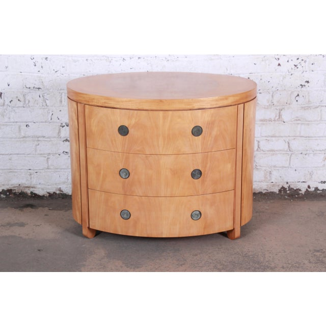 A rare and exceptional Art Deco style primavera three-drawer commode or bachelor chest by Baker Furniture. From the only...