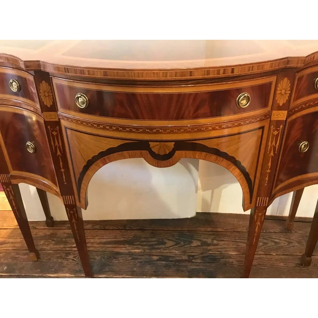Absolutely gorgeous meticulously inlaid mixed wood console, sideboard or credenza, having 3 drawers across the top and two...