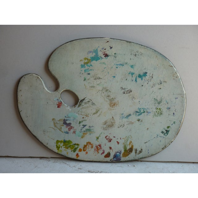 20th Century artist palette with remains of dried paint.