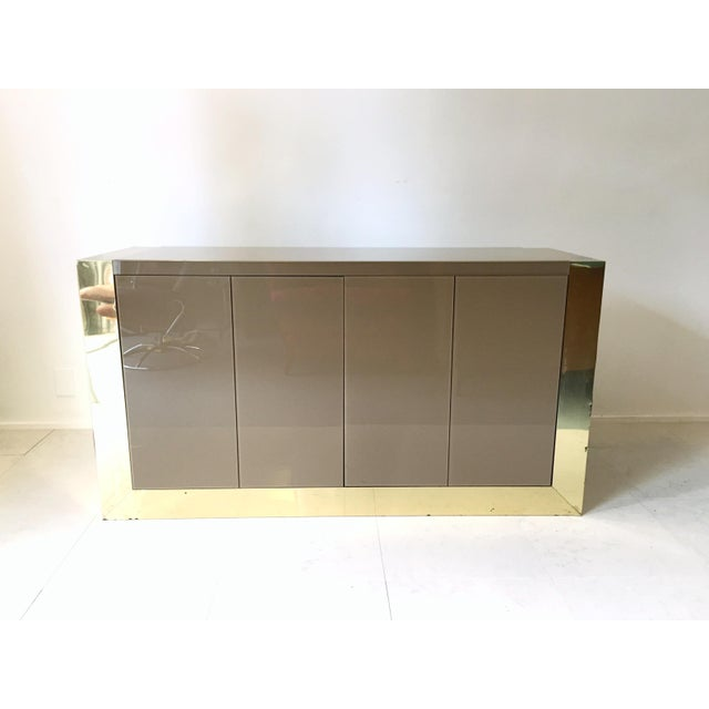 Paul Evans server finished in brass-plate, with a reverse-painted acrylic top . The cityscape series is a well loved and...