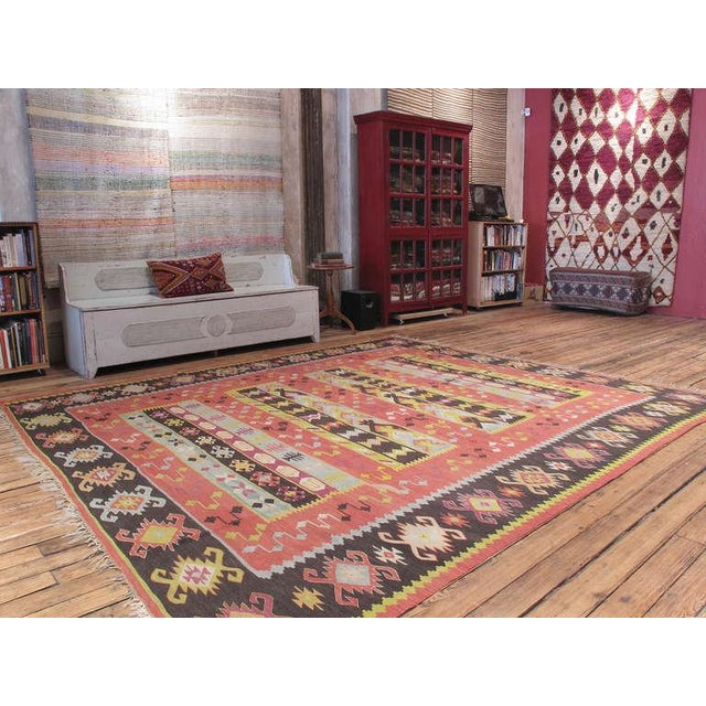 An old Kilim in large format from the Balkan Peninsula (Serbia-Bulgaria region), in characteristic colors, featuring a...