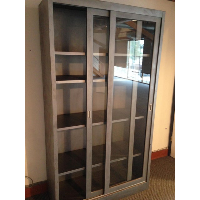 Large Industrial display cabinet or bookcase with glass sliding doors. Features a case constructed from medical grade...