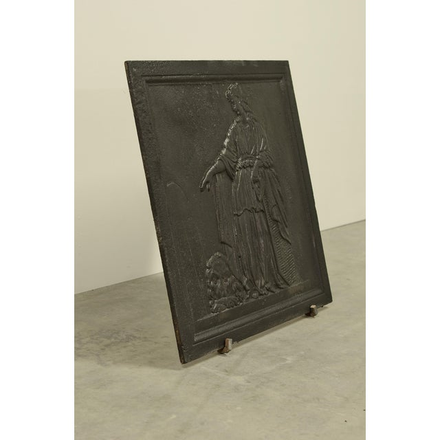Sharp, square and decorative cast iron antique fireback. Mourning Queen next to a grave with a lion at her feet in...