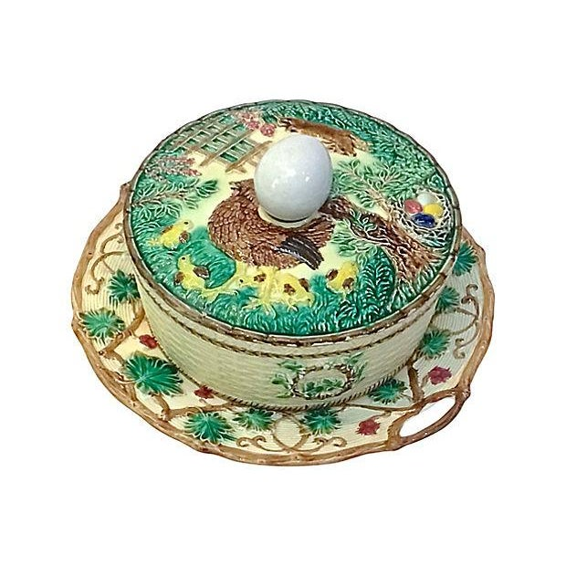 Antique; 19th century, French, majolica, farm animal and basket tureen with egg handle lid and ceramic underplate. The...