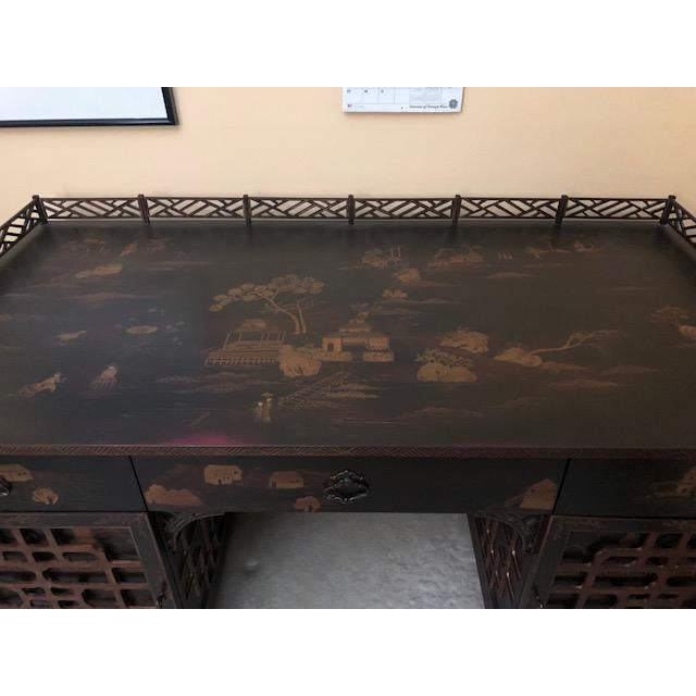 This is a Mandalay Drexel Heritage desk from the late 20th century. The piece is in the chinoiserie style, decorated with...